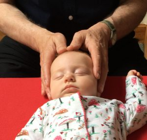Baby having Craniosacral Therapy